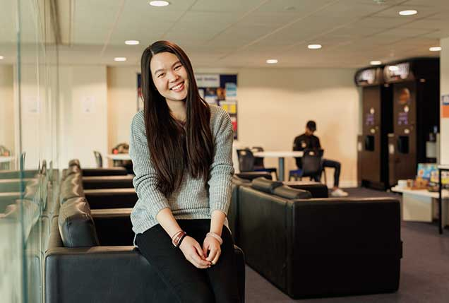 An international student in the common room area of the University of Leicester International Study Centre