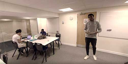 An international student giving a tour of St Georges Tower, the accommodation for the University of Leicester International Study Centre