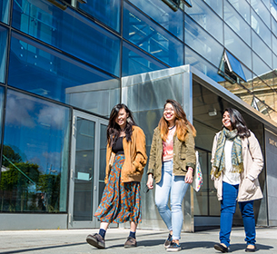 Students walking through Leicester campus